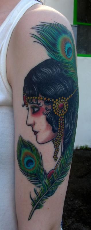 girl head with peacock feathers