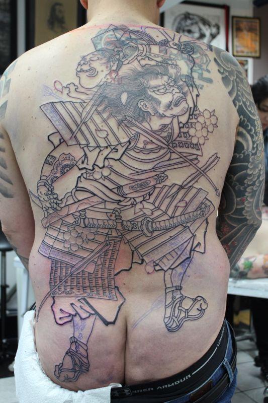 Samurai Throwing a Severed Head
