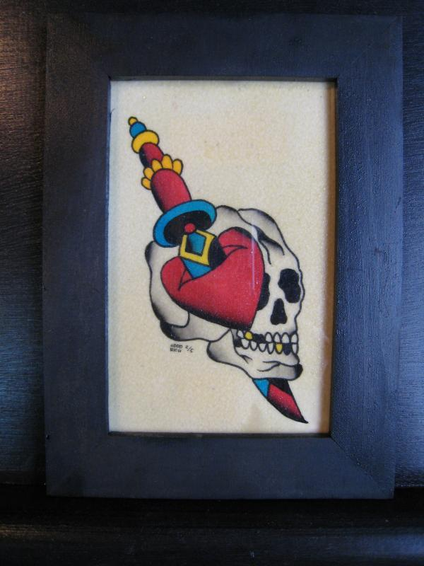skull with dagger and heart