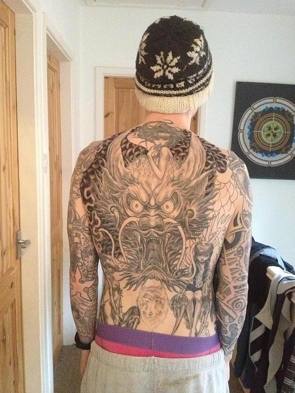 Next session on back piece, wolf started lasering
