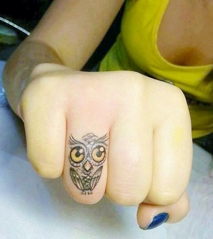 Finger owl tattoo