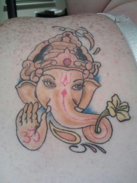Ganesh with yellow hibiscus