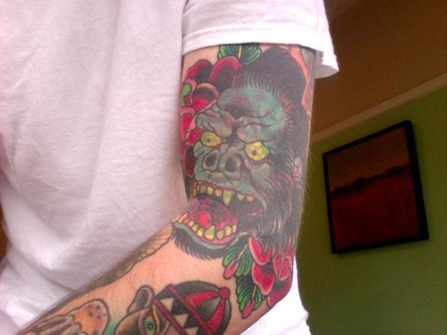 Gorilla destroys shitty tattoo