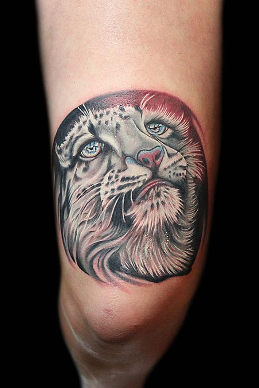 Snow Leopard tattoo