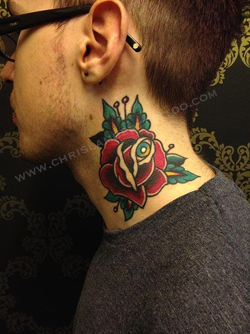 Rose with eye tattoo