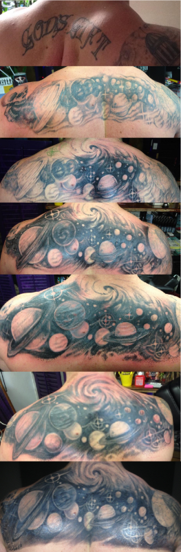 Back cover up planet tattoo