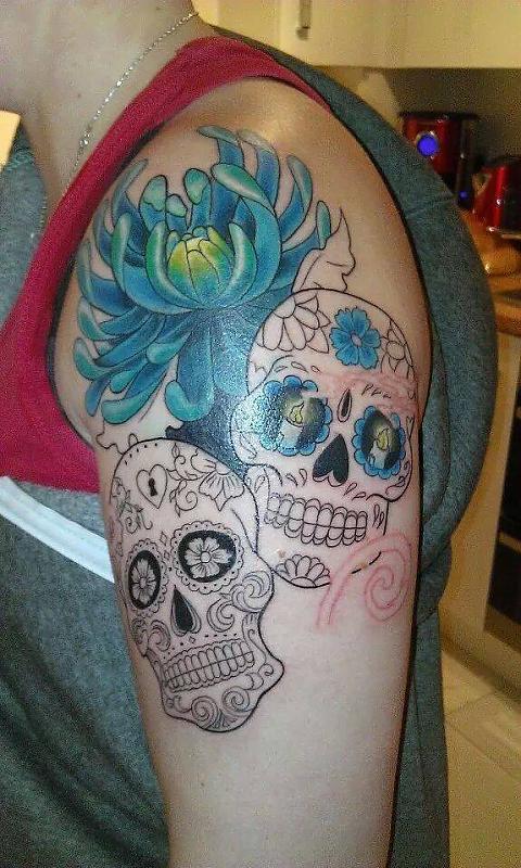 start of sugar skull cover up tattoo