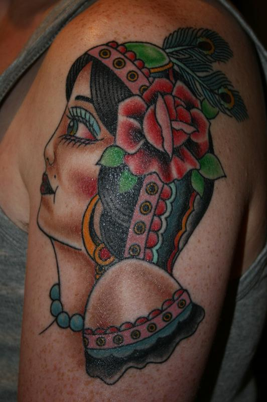 lady head with rose and peacock feather