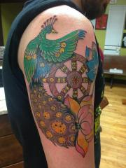 peacock and wheel of life