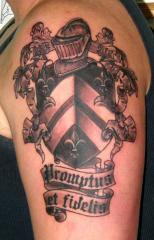 black and grey family crest coat of arms
