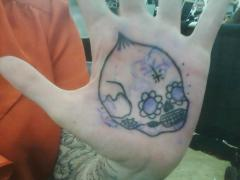 sugar skull on palm