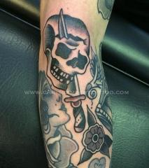 skull and dagger tattoo on forearm