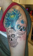 start of sugar skull cover up tattoo