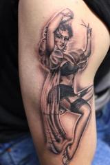 Black and grey pin up girl tattoo
