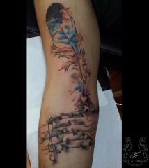 Feather/Music tattoo