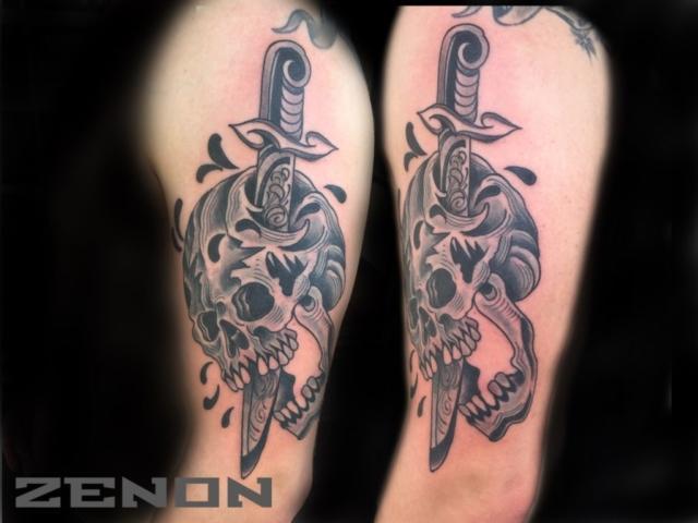 Skull with knife tat.jpeg