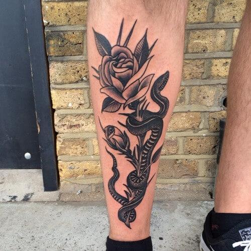 Black-Ink-Snake-With-Rose-Tattoo-On-Left-Leg.jpg